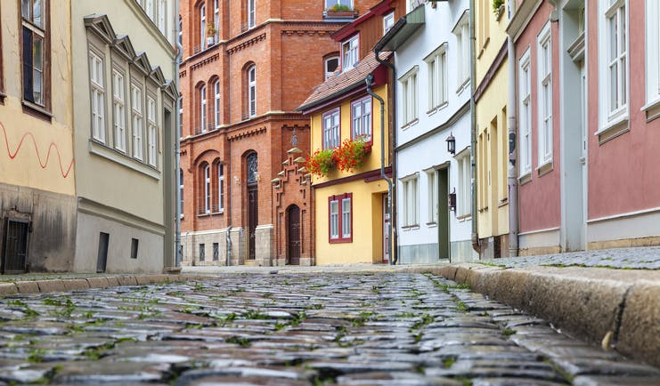 Cobbled street and old pink houses in Erfurt