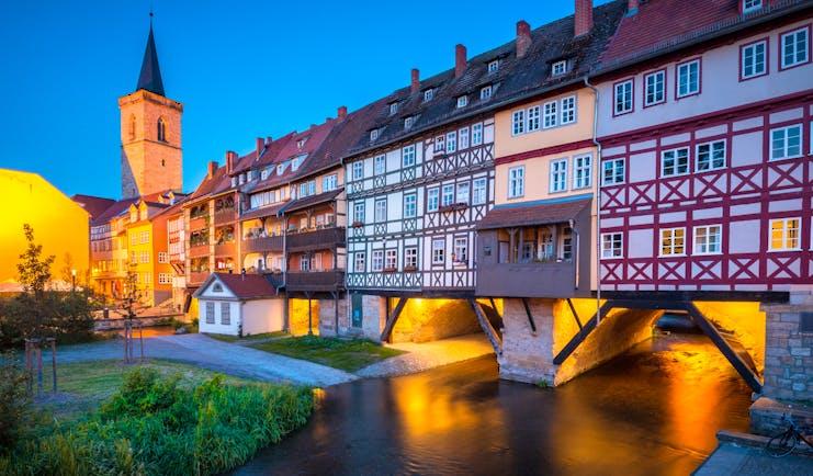 Half timbered houses at night on bridge in Erfurt