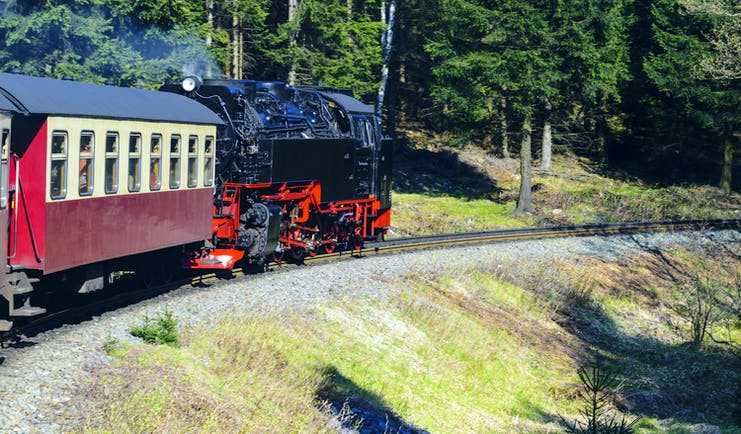 Black and red steam train in Harz mountains
