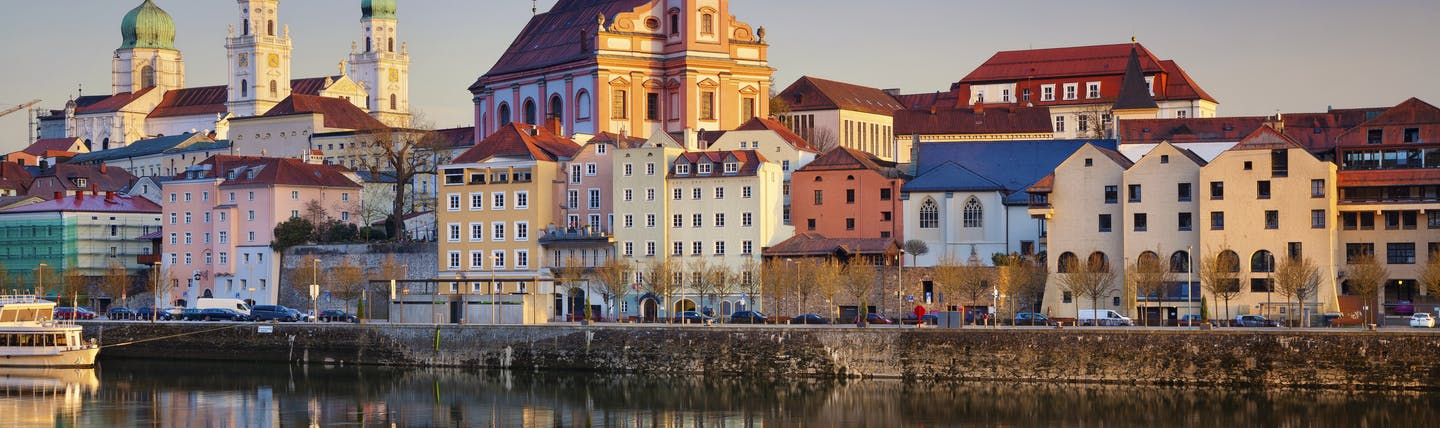 Sunset over pretty coloured houses and churches in Passau