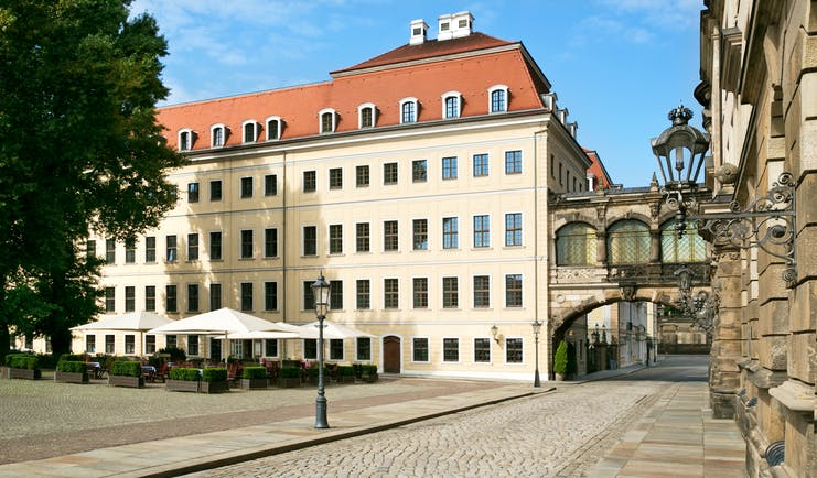Taschenbergpalais bistro terrace, outdoor dining area in main square, infront of hotel bulding
