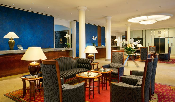Taschenbergpalais lobby and reception area, sofas and chairs, colourful and elegant decor