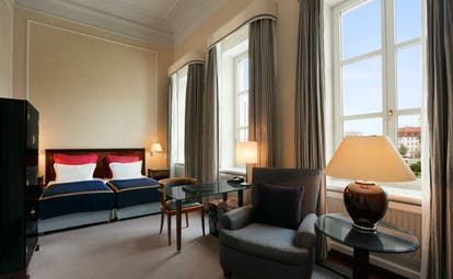 Taschenbergpalais superior room, double bed, armchairs, large windows, bright elegant decor