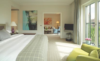 Classic suite at the Charles Hotel with large double bed and bi-folding doors opening onto a balcony