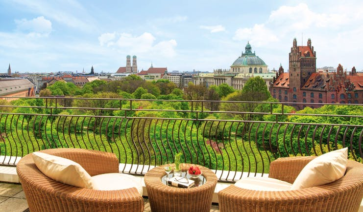 View from the balcony of the Monforte suite looking over Munich and lots of greenery