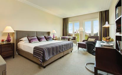 Superior deluxe room at the charles hotel with large bed, doors opening onto a balcony and a flat screen television