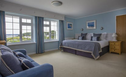 St Michael's Resort spacious bedroom with blue walls and views of the sea