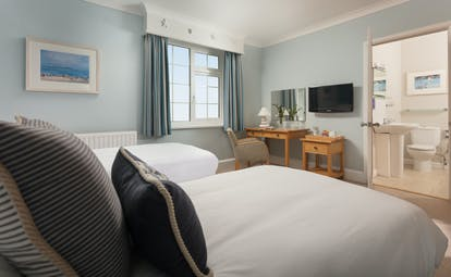 St Michael's Resort bedroom with white covers and blue walls