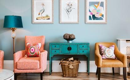 Horn of Plenty Devon orange chairs and blue cupboard
