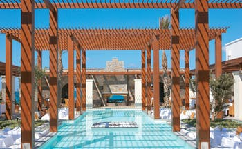 Amirandes Greece outdoor pool and pergola outdoor seating area