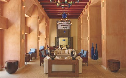 Blue Palace Greece lounge south wing area with terracotta walls and lanterns
