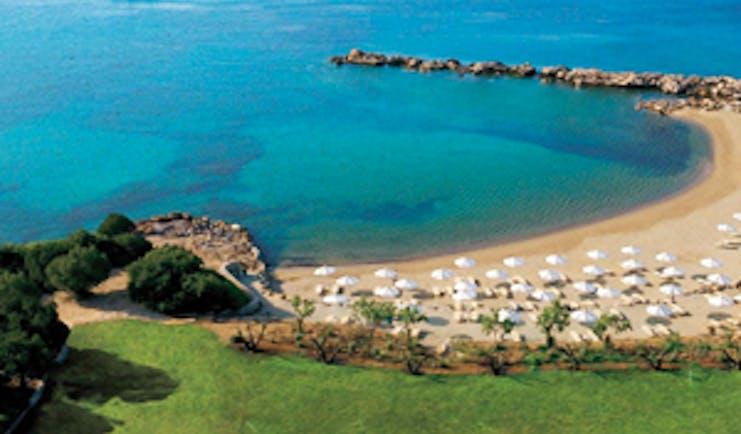 Cape Sounio Greece beach ocean sun loungers umbrellas boats on the waves