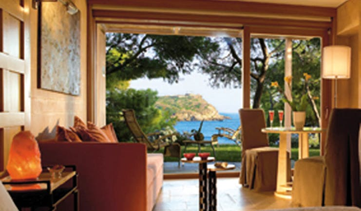 Cape Sounio Greece bungalow living room deck sitting area sea view