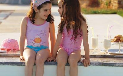 Cape Sounio Greece children sitting next to a swimming pool