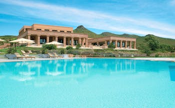 Cape Sounio Greece exterior shot ancient Greek style building outdoor pool