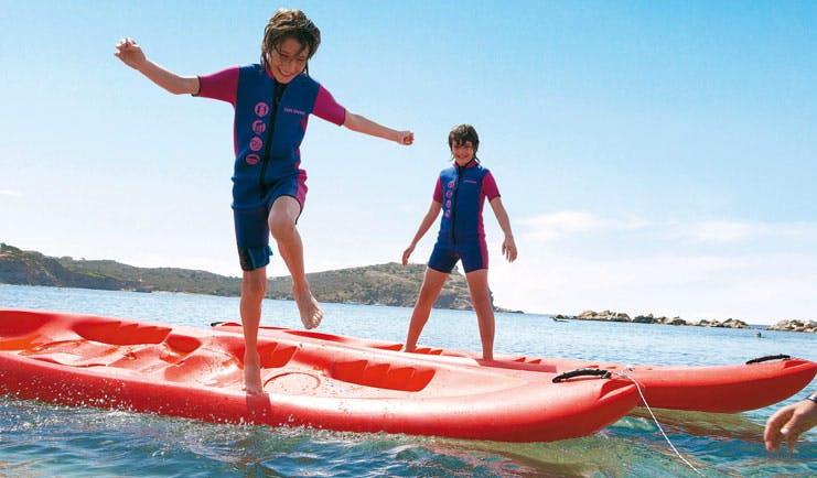 Cape Sounio Greece kids club group of children in wetsuits and snorkels