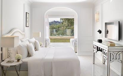 White bedrloom opening onto garden Corfu Imperial