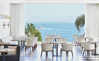 White restaurant with sea views Corfu Imperial