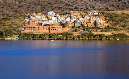 Domes of Elounda Greece panorama view of terracotta buildings from the sea