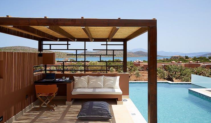 Domes of Elounda Greece  private pool veranda desk and sofa