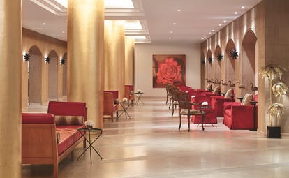 Red seating in lobby with light from overhead