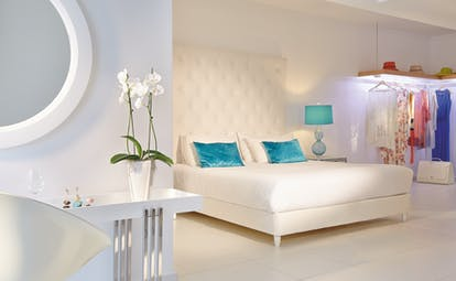 Grecotel White Palace white suite with flowers and green cushions