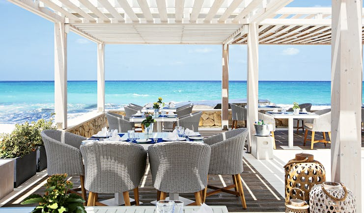 Grecotel White Palace restaurant by the sea
