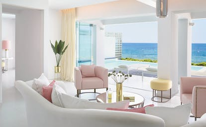 Grecotel White Palace suite opening onto pool with sea view