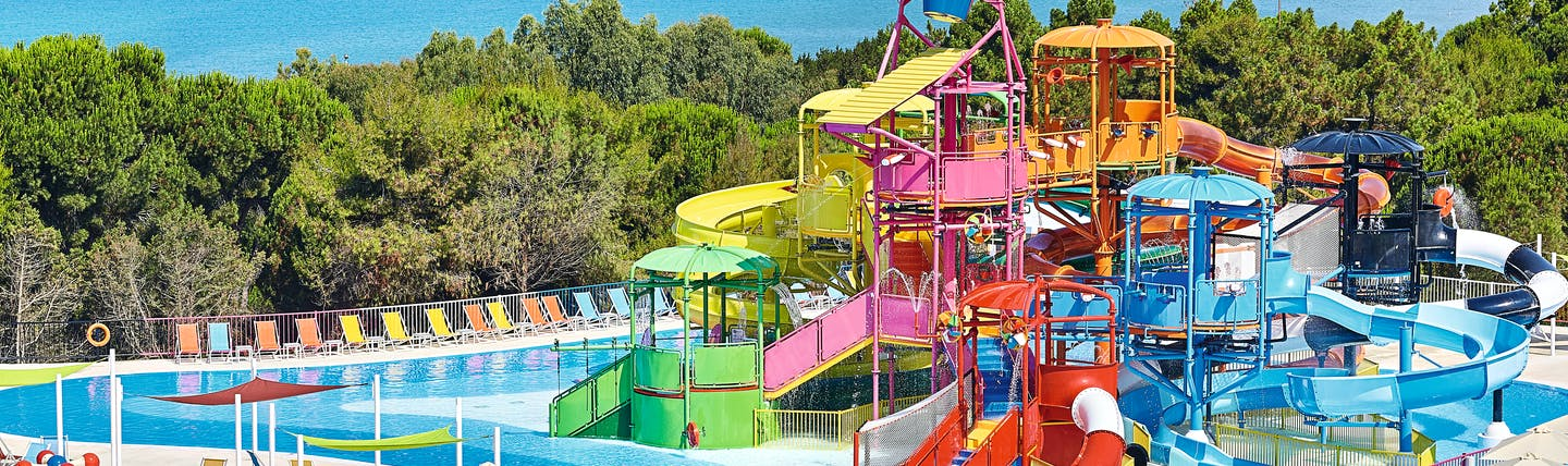 Grecotel Mandola Rosa Greece play area multi story childrens play area next to pool