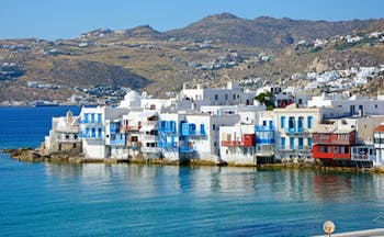 Little Venice in Mykonos, waterfront houses, mountain in background