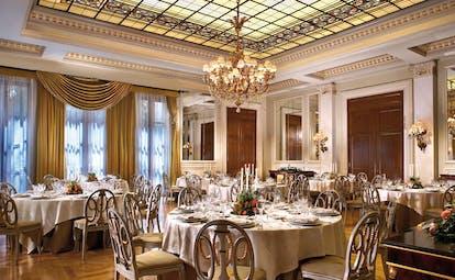 Hotel Grande Bretagne Greece dining room opulent decor chandeliers glass roof