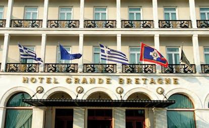 Hotel Grande Bretagne Greece exterior signage Greek flags balconies