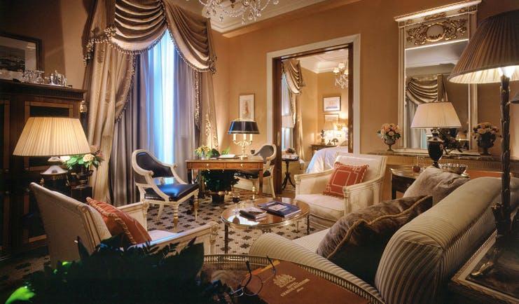 Hotel Grande Bretagne Greece lounge sitting area opulent decor chandelier view of bedroom