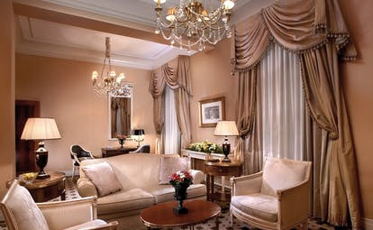 Hotel Grande Bretagne Greece sitting room opulent traditional decor chandeliers draped curtains