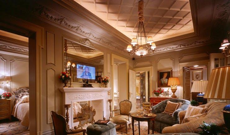 Hotel Grande Bretagne Greece suite lounge sitting area opulent decor fireplace view into bedroom