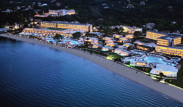 Ikos Dassia Greece aerial view of hotel swimming pools and beach at night