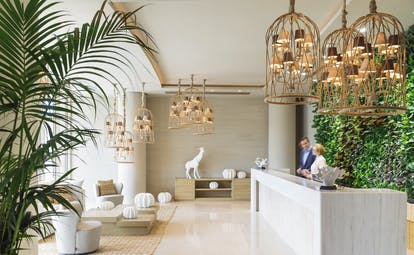 Ikos Dassia Greece lobby with vegetal wall and wooden chandeliers
