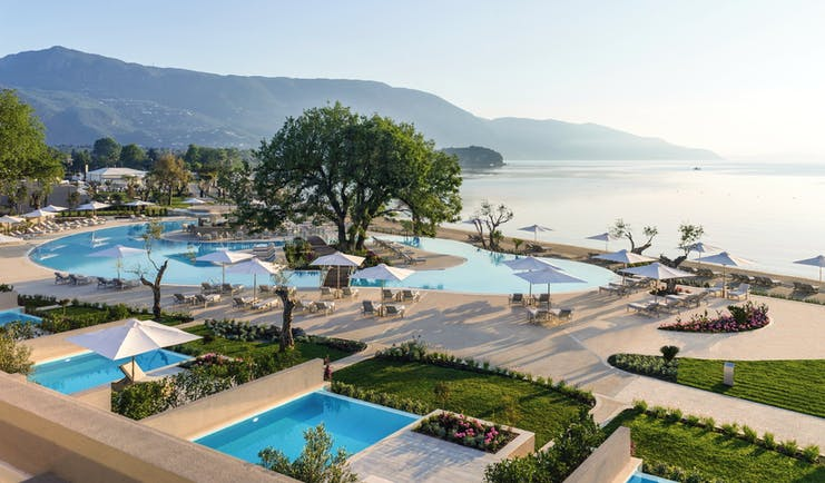 Ikos Dassia Greece aerial panorama outdoor pool with tree in the centre and sea view