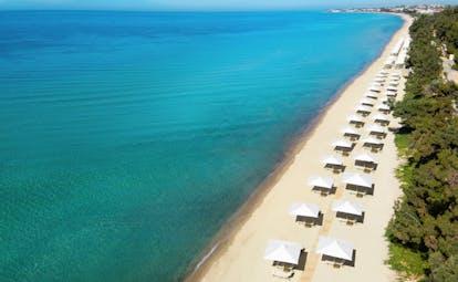 Ikos Oceania Greece beach with many white pergolas