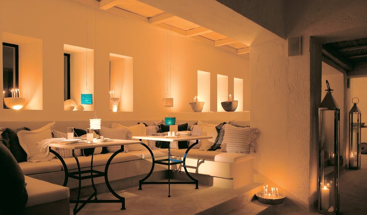 Mykonos Blu Greece Grecotel lounge with sofas and candles