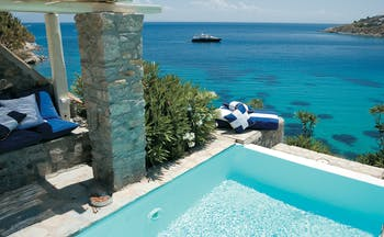 Mykonos Blu Greece Grecotel private pool with stone walls and beach view