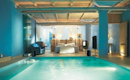 Mykonos Blu Greece Grecotel villa bedroom pool suite with blue walls and wooden roof