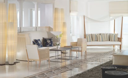 Mykonos Grand Hotel Greece lobby area with two large white sofas