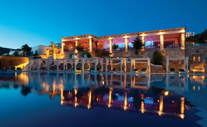 Mykonos Grand Hotel Greece pool at night with cabanas