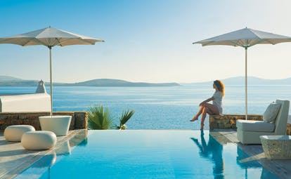 Mykonos Grand Hotel Greece pool sea outdoor woman sitting at private pool with sea view