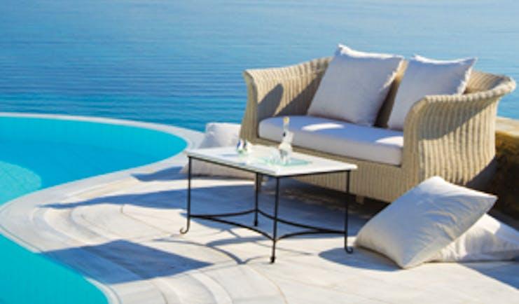 Mykonos Grand Hotel Greece pool sea view small sofa