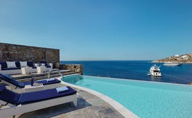 Petasos Beach Resort Greece outdoor pool private with seating area loungers and sea view