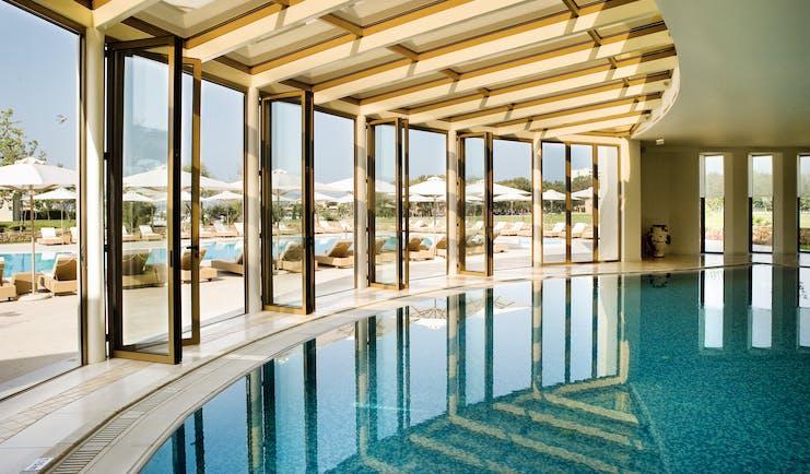 Porto Sani Greece indoor pool with large windows