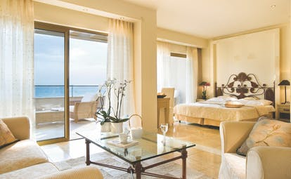 Sani Asterias Greece junior suite double bedroom seating area balcony with sea view