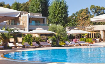 Sani Asterias Greece outdoor pool with sun loungers and umbrellas